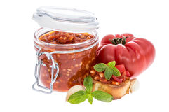 Bruschetta Sauce in a glass on white Stock Photo