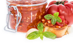 Bruschetta Sauce in a glass on white Royalty Free Stock Image