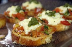 Bruschetta with sliced tomatoes and onion Royalty Free Stock Photo
