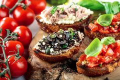 Bruschetta, on slices of toasted baguette garnished with basil. stock image
