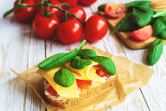 Bruschetta with spinach and cherry tomatoes on toasted baguette Stock Photography