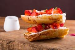 Strawberry bruschetta on wooden background royalty free stock photo