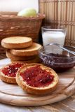 Bruschetta with strawberry jam. Italian food, bruschetta with jam, milk and fruits placed on a wood Royalty Free Stock Photo