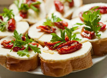 Bruschetta with sun dried tomatoes and mozzarella Royalty Free Stock Photography