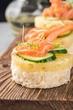Bruschetta toast of white bread with slices of pineapple cucumber fish salmon fresh green sprouts royalty free stock photography