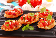 Bruschetta toasted on electric grill Royalty Free Stock Photo
