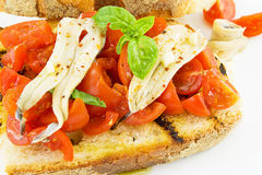 Bruschetta with tomato and anchovies Stock Photos