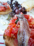 Bruschetta with tomato and anchovy. Bruschetta antipasto with tomato and anchovy and olives Stock Images