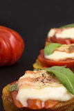 Bruschetta with tomato and bacon Royalty Free Stock Image