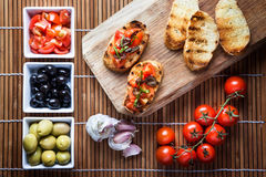 Bruschetta tomato basil and olives Royalty Free Stock Images