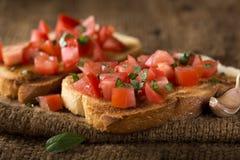 Bruschetta with tomato and basil Stock Photos