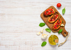 Bruschetta with Tomato and Basil in Top View Copy Space royalty free stock images