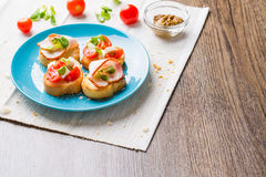 Bruschetta with tomato, cheese and bacon Stock Image