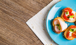Bruschetta with tomato, cheese and bacon Stock Images