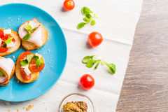 Bruschetta with tomato, cheese and bacon Royalty Free Stock Photo