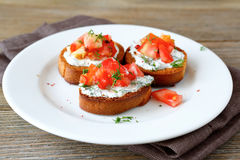 Bruschetta with tomato and cheese Royalty Free Stock Images