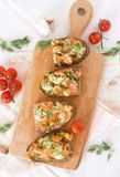 Bruschetta with tomato, cheese and garlic stock images
