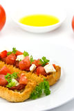 Bruschetta with tomato,cheese and other stuffing Stock Photo
