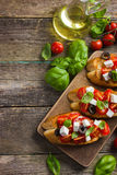 Bruschetta with tomato, feta cheese and basil Royalty Free Stock Images
