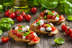 Bruschetta with tomato, feta cheese, olives and basil Stock Image