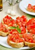 Bruschetta with tomato. Fresh bruschetta with tomato and basil Royalty Free Stock Photos