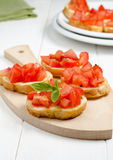 Bruschetta with tomato. Fresh bruschetta with tomato and basil on cutting board Royalty Free Stock Images