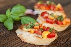 Bruschetta with tomato, garlic, basil Royalty Free Stock Image