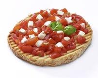 Bruschetta with tomato, mozzarella and basil Stock Photography