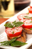Bruschetta with tomato, mozzarella and basil Stock Photography