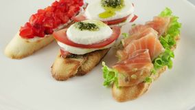 Bruschetta with tomato, mozzarella and salmon stock footage