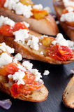 Bruschetta with tomato, onion and goat cheese Royalty Free Stock Photography