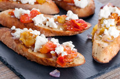 bruschetta with tomato, onion and goat cheese Stock Photography