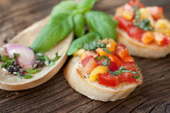 Bruschetta with tomato, paprika, garlic, basil Royalty Free Stock Image
