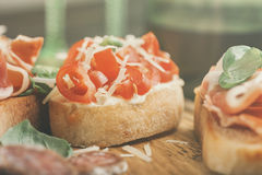 Bruschetta with tomato, parmesan cheese and basil Stock Photos