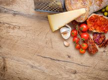 Bruschetta with tomato paste, tomatoes, cheese, garlic and fuet. Royalty Free Stock Image
