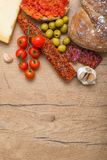Bruschetta with tomato paste, tomatoes, cheese, olives, garlic and fuet. Stock Images