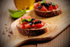 Bruschetta with tomato pieces Stock Photography