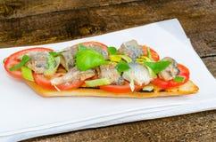 Bruschetta with tomato, sardines Royalty Free Stock Images