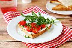 Bruschetta with tomatoes and arugula Royalty Free Stock Photography
