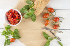 Bruschetta, tomatoes,basil ,ciabatta with vintage knife and fork Stock Images