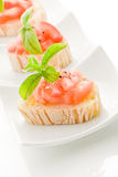 Bruschetta with tomatoes and basil isolated Stock Photography