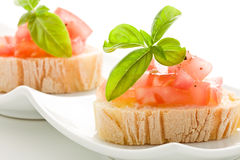 Bruschetta with tomatoes and basil isolated Royalty Free Stock Image