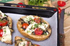Bruschetta with tomatoes, cheese and mushrooms Royalty Free Stock Images