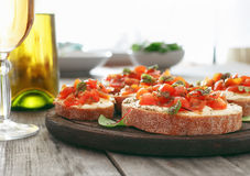 Bruschetta with tomatoes, goat cheese and basil Royalty Free Stock Images