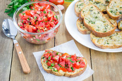 Bruschetta with tomatoes, herbs and oil on toasted cheese bread Royalty Free Stock Photo