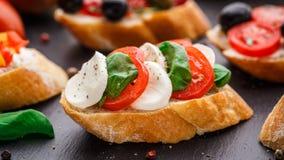 Bruschetta with tomatoes, mozzarella and basil Royalty Free Stock Photo
