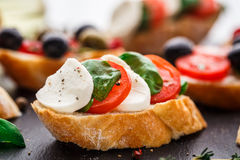 Bruschetta with tomatoes, mozzarella and basil Stock Images