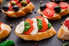 Bruschetta with tomatoes, mozzarella and basil Stock Image