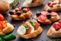 Bruschetta with tomatoes, mozzarella and basil Stock Photos