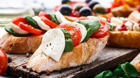 Bruschetta with tomatoes, mozzarella and basil Stock Photography